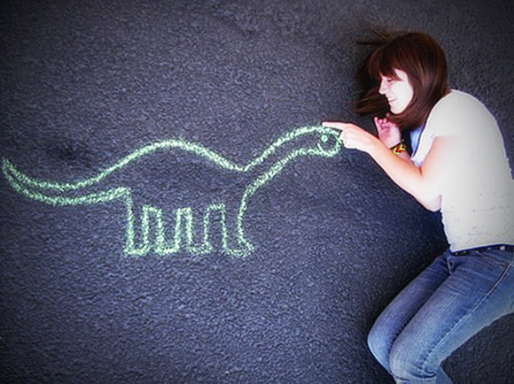 dino-love-luv-chaulk-drawing-of-dinosaurus-girl-laying-in-road
